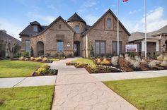 Brick and stone elevation. plantationhomes.com/dallas-ft-worth/harvest-60ft-homesites