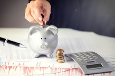 Female Hand Putting Coin In Piggy Bank On The Office Desk Stock Image - Image of economy, ceramic: 41084697