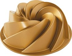 Make delicious Bundt cakes with the premier Nordic Ware Premier Gold Bundt Pan. Boasting heavy cast aluminum construction for uniform and even baking, this useful pan is a staple in the kitchen of any baker and features a gorgeous golden color. Bundt Cake Pan, Cake Pans, Bundt Pans, Almond Pound Cakes, Aluminum Pans, Loaf Pan, Small Cake, Golden Color, Quick Bread