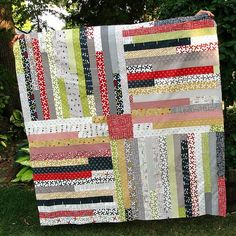Four Corners Quilt Tutorial (Jelly Roll Races Quilt with a Twist) great tutorial with pictures.
