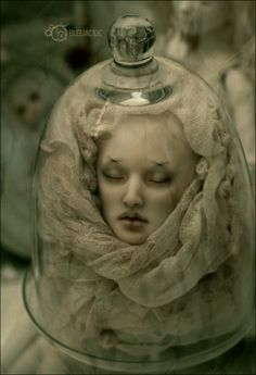 Halloween Props-Doll head in glass cloche makes for a very  spooky Effect.   Creepy...