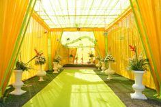parrot green carpets, yellow and green decor, yellow and green drapes, day light decor, floral vases Desi Wedding Decor, Wedding Hall Decorations, Marriage Decoration, Wedding Mandap, Floral Wedding, Wedding Events, Wedding Ideas, Wedding Walkway, Wedding Entrance