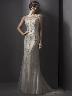 Sottero and Midgley - EVELINA, Vintage romance is found in this gorgeous sheath gown, comprised of luxurious Palatzo satin with glamorous tulle overlay, accented with glittering Swarovski crystals. Complete with illusion neckline and finished with covered button and zipper back closure.