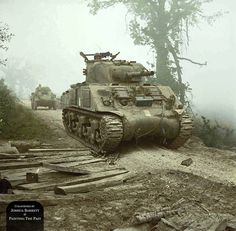 A Sherman Tank and (what looks like) a Humber Armoured Car sit on a foggy hilltop road, waiting for the call to advance during the Final Battle for Monte Cassino. Cassino, Italy, 13th May, 1944.