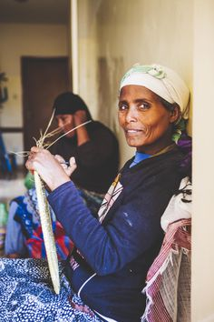"""""""This type of weaving is a tradition in my village, so I've always known how to make these baskets. I also work as a launderer."""" says Tewabech, an artisan from Ethiopia © ITC Ethical Fashion Initiative & Louis Nderi"""