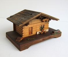 Vintage rustic 1960s wooden Swiss alpine house music box. $24.00, via Etsy.
