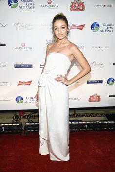 Gigi Hadid wears a white strapless Tommy Hilfiger dress