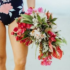 how about this tropical bouquet from today's hawaii-inspired engagement session #NowOnGLW // styling @tolalune // photography @aubree.lynn // florals @bloombabes // bracelets @stackedcollection // earrings @jetsilverbeads