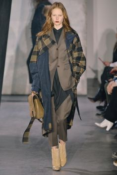 Layers on layers on layers are lending bespoke suiting a street edge at the @31philliplim #NYFW #AW15 show