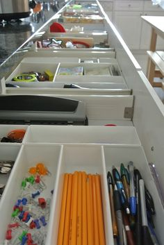 Kitchen Organization – The Drawers - I like the idea of using cheaper silverware containers to organize junk drawer items.