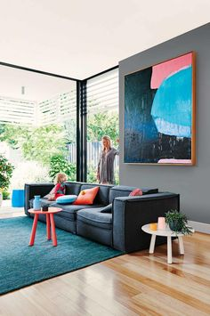 Get the look: living room with colourful accents. From the April 2016 issue of Inside Out magazine. Styling by Heather Nette King. Photography by Lisa Cohen. Artwork by Andrew O'Brien (andrewobrienartis...). Available from newsagents, Zinio,www.zinio.com, Google Play, play.google.com/..., Apple's Newsstand, itunes.apple.com/..., and Nook.