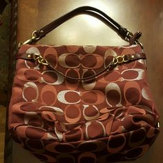 Burgundy COACH bag This is a medium to large coach bag. It is pre-owned but in great condition, not pristine.   Gorgeous burgundy and gold colors.   14.5 inches across.  12 inches length.  Can be worn over the shoulder or carried as a handbag.  Please ask questions. Coach Bags Shoulder Bags