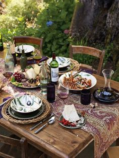 This table setting would be great for my next Tuscan Italian meal. The cheese board looks fabulous.