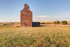 A derelict wooden grain elevator in a ghost town.
