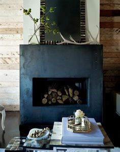 cozy reclaimed wood with juxtaposing industrial fireplace = love it