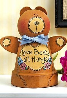 Love Bear Clay Pot Crafts 'n things Craft of the Day. This Love Bear Clay Pot is adorable and cute! Flower Pot Art, Clay Flower Pots, Flower Pot Crafts, Clay Pot Projects, Clay Pot Crafts, Diy Clay, Flower Pot People, Clay Pot People, Clay Bear
