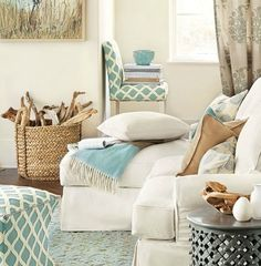 Coastal living room. Wicker basket is filled with driftwood. More ideas here: http://www.completely-coastal.com/2016/01/decorating-with-wicker-baskets-stylish.html