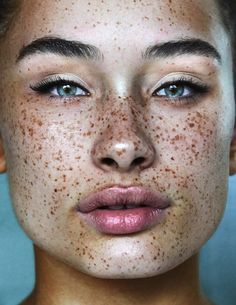beautiful freckled face close up