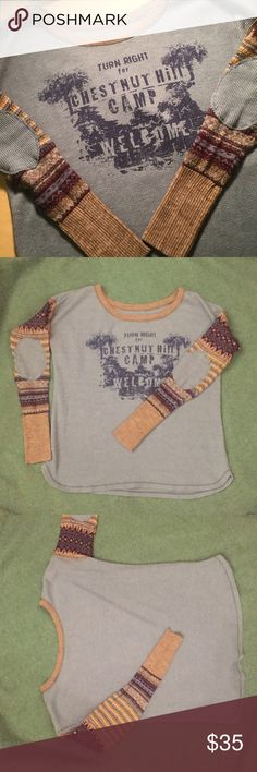 Free People Alpine Sleeve Graphic Thermal Adorable Free People Thermal! The body is waffle knit with a graphic design. The sleeves are sweater material with thermal elbow patches. The body is a slouchy fit but the sleeves don't have much stretch to them. Excellent condition! Free People Sweaters Crew & Scoop Necks