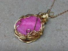 #152 Pink druzy pendant wire wrapped with brass