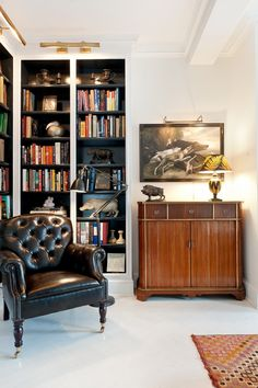 East Village: George Smith Chair, Jansen vintage console from Greenwich Living, library lights from Circa lighting, bookcase Farrow and Ball 'Railings'