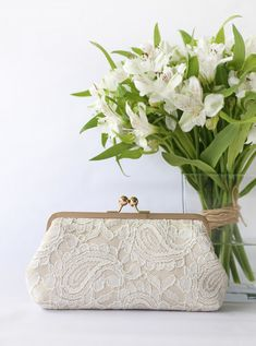 This elegant ivory and champagne lace clutch, made with a layer of Alencon paisley lace over champagne satin is perfect gift for all occasions - weddings, bridal shower, bridesmaids, mother of bride, mother of groom and loved ones. Clutch details of this listing: Base Fabric: Satin in