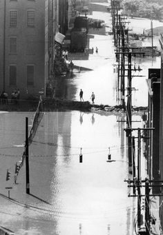 Hurricane Camille's Floodwaters in Richmond. It arrived in Virginia the night of August 19, 1969. One of the worst natural disasters in Virginia's history. As it swept through Virginia overnight. Hurricane Camille cost Virginia 113 lives lost and $116 million in damages. Sandbags at intersection of Cary & 18th streets failed to stop flooding in Richmond. | Original Author: Bill Lane | Created: August 23, 1969 | Richmond Times-Dispatch