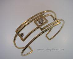 Viccellio Goldsmith. Handmade cuff bracelet in 14k gold and diamonds. Frank Lloyd Wright inspired design.