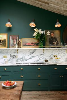 Gorgeous emerald green kitchen cabinets, brass hardware and lighting, marble…