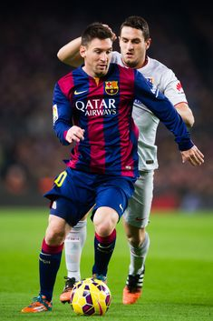 Lionel Messi of FC Barcelona runs with the ball next to Jorge Resurreccion 'Koke' of Club Atletico de Madrid during the La Liga match between FC Barcelona and Club Atletico de Madrid at Camp Nou on January 11, 2015 in Barcelona, Catalonia.