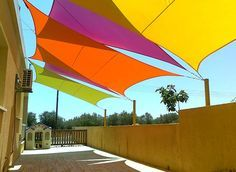 Shade sail - great way to give shade. Can be taken down when it's not needed. Loads of colour choices.