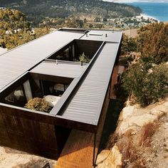 """The Kingston house remains unobtrusive and well camouflaged on its hillside site despite the architects' use of modernist geometry. The outer cladding is simply plywood stained with dark Madison oil."" See full story on Dwell.com  Architecture: @room11__  Photo: Andrew Rowat @andrewrowat / #dwell #architecture #australia"
