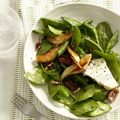 Spinach, Pear, and Gorgonzola Salad With Pecans:  This recipe is a delicious mix of sweet pears with tangy Gorgonzola cheese and salty pecans. For a seasonal switch-up, you can use strawberries or peaches in place of the pears. | Health.com
