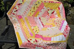 Lucy & Norman: Wow! I finished a quilt! I love the non-traditional shape!