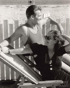 Douglas Fairbanks Jr. and Joan Crawford sharing a beach chair in Malibu,1929.