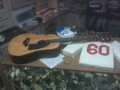 Guitar and hockey jersey cake by PM Frosted Fantasies www.PMCakes.com in Toledo Ohio