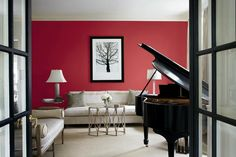 French doors frame a subdued red in a sitting room fit for a warm reception. | Quite Red 1011-3, @Valspar