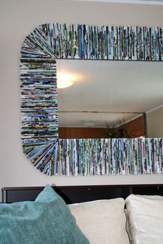 recycled magazine page DIY mirror frame. This might be something to do with old text books if I can't sell them. :-)
