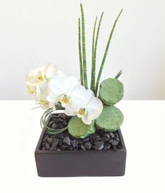 Here is our Art of Zen arrangement featuring white orchids which bring abundance, beauty, and spiritual growth into your life! Ikebana, Silk Flowers, Dried Flowers, Altar Flowers, Art Floral, Tropical Wedding Centerpieces, Modern Wedding Flowers, Zen Wedding, Floral Design Classes