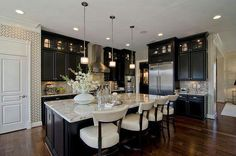 Kitchen - Meritage Homes. Love the dark cabinets and wood floors..| #YvetteLongInternational