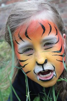 Tiger face painting by professional Brighton face painter Katie Paint Face  www.katiepaintface.co.uk  facebook.com/katiepaintface