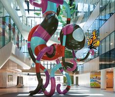 Royal Children's Hospital. Sculpture by artist Jade Oakley, creating a canopy of colour and movement. Throughout the building, graphics by Melbourne illustrator Jane Reiseger depict landscapes and animals from around Victoria, bringing the positive energy of the landscape surrounding the building to all parts of the hospital.