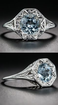 Aquamarine Art Deco Filigree Ring, Delicately die-struck and hand finished with fine scalloped lace-like filigree, this striking late-Art Deco ring (circa 1930s) features a round faceted aquamarine, mounted in a stylized 8-pointed star and imbued with exceptional light return and scintillation.