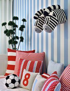 Ana Cordeiro - boy's rooms - stripe walls, red and blue, red gingham pillows, red stripe pillows, blue gingham pillows, soccer ball pillow, fabric zebra heads, wall-mount fabric zebra heads, red and blue boys bedrooms,