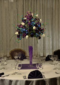purple stock, white roses, blue orchids