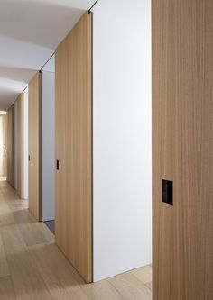 Sliding doors are used to delimit rooms and at the same time work as corridor coating or to enclosure the module itself. To do so, the hollowed and solid areas are designed at millimeter, the lace of the sliding doors integrate both functions.  RM apartment by Francesc Rifé Studio