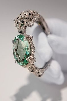 Cartier ~ Panther bracelet with green beryl.