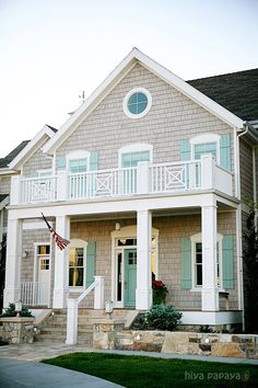 Love the colors(bb) Lovely home with weathered cedar shake siding and wooden shutters painted in Benjamin Moore's color of the year, Wythe Blue (via House of Turquoise: Bathroom) Exterior House Colors, Exterior Paint, Exterior Design, Grey Exterior, Stone Exterior, Cape Cod Exterior, Exterior Shutters, House Of Turquoise, Turquoise Door