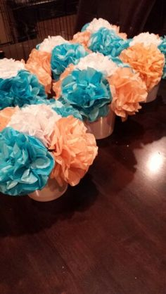 What I made for my sis-n-law's baby shower: Coral & teal flower centerpieces made of tissue paper