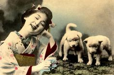 TWO PUPS AND A PEACH -- A Young Maiko and Her Little Friends    Oh yeah, that's one happy smile.    Ca.1900-05 Meiji-era hand-colored photo by an unknown Japanese photographer  By Okinawa Soba